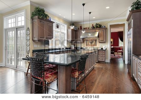 Elegant Kitchen With Black Marble Island