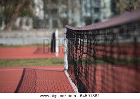 Tennis Court Net And Court Beyond