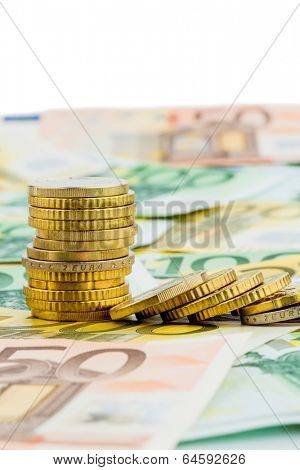 single stack of coins lying money coins symbol photo for investment, risk and profits slump