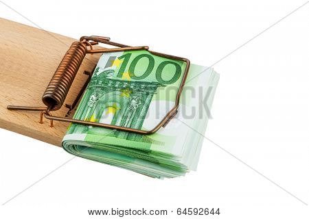 many euro banknotes in a mousetrap. symbolic photo for debt and debt with loans.