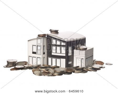 House Model Standing On American Coins