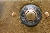 image of combination lock  - Antique dial combination lock close up - JPG