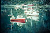 picture of reining  - Fishing boat in harbour Reine Lofoten Islands Norway - JPG