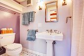 stock photo of guest-house  - Lavender walls bathroom with white appliances - JPG