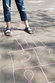 image of hopscotch  - girl playing in hopscotch outdoors in sunny day - JPG