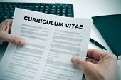 foto of labourer  - man in his office checking a curriculum vitae - JPG