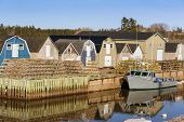 image of lobster trap  - Lobster traps stacked on the wharf in rural Prince Edward Island - JPG