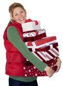 pic of christmas-present  - A woman with an armful of presents after going christmas shopping - JPG