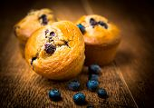 picture of home-made bread  - home made blueberry Muffins On Wooden Table - JPG
