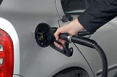 picture of high-octane  - Male hand refilling the car with fuel on a filling station - JPG