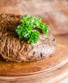 image of porterhouse steak  - Angus Beef Steak with Parsley Leaf On The Board - JPG