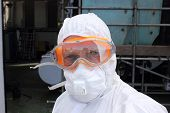 stock photo of ppe  - an industrial employee in full personal protection equipment - JPG