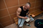 foto of tupperware  - Bodybuilder Eating Healthy Bodybuilding Diet Food Out Of Tupperware - JPG
