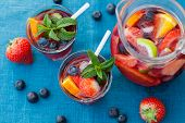 stock photo of sangria  - Refreshing sangria (punch) with fruits and berries