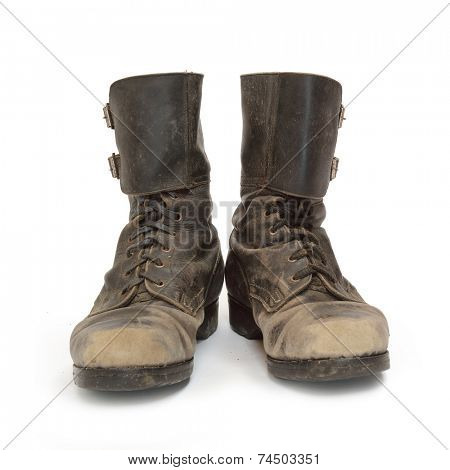 Old army combat boots on white background.