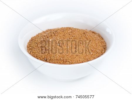 Coconut Sugar In A White Bowl Against White