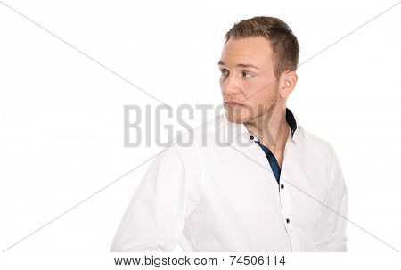 Portrait: Isolated unhappy blond man looking disappointed sideways.