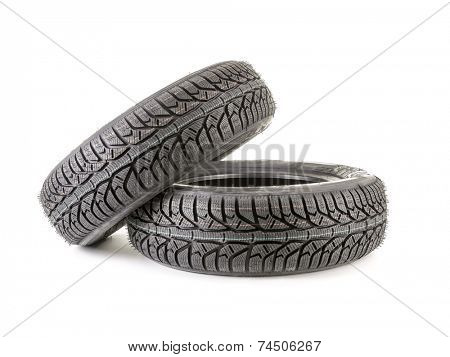Pair of winter car tyres shot on white