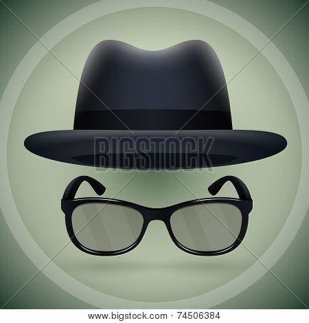 Black fedora and eyeglasses.