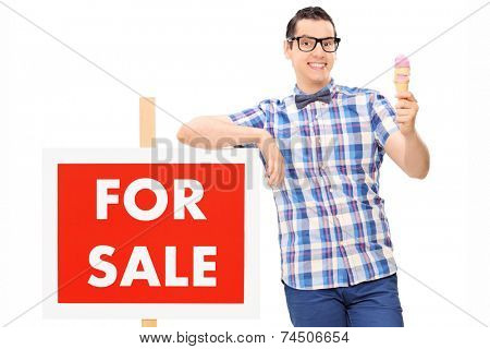 Man holding an ice cream by a for sale sign isolated on white background