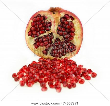Juicy Pomegranate Fruit With Seeds Isolated Against White