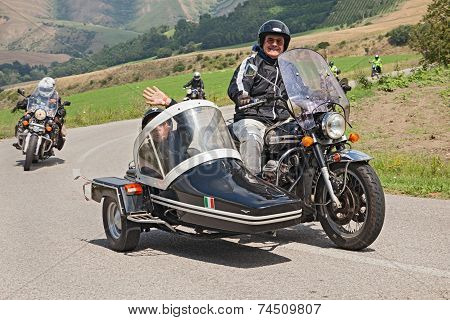 Bikers On A Vintage Moto Guzzi California V850 With Sidecar