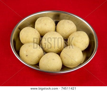 Indian Laddoo Treats In A Silver Plate Against Red Tablecloth