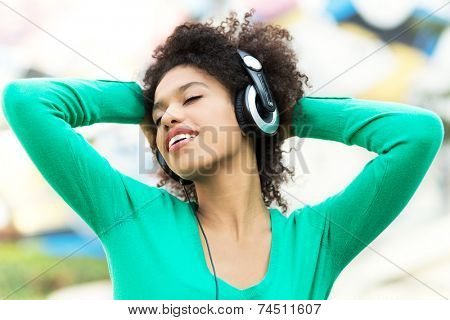 Afro-American woman listening to music