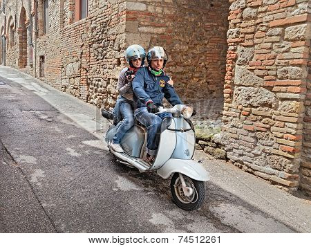 Couple Riding A Vintage Scooter Lambretta