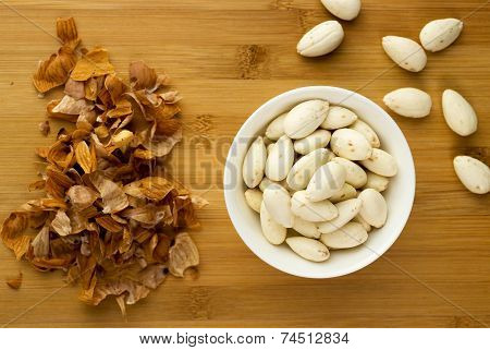 Blanched Almonds In A Bowl Next To Almond Peels