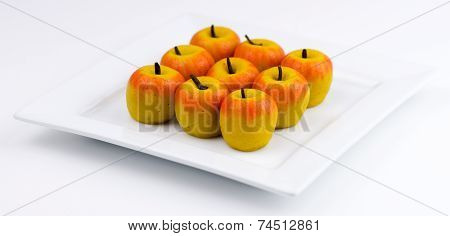Traditional Indian Apple Shaped Barfi On White Background