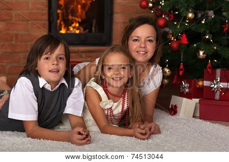 Family laying by the fire on Christmas eve - enjoying the time together