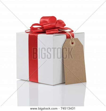 Gift Box With Handmade Red Ribbon Bow And Tag