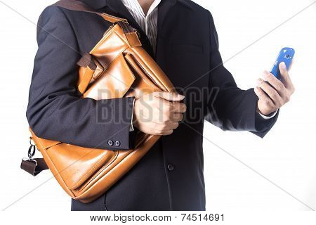 Business Man With Briefcase And Using Smartphone