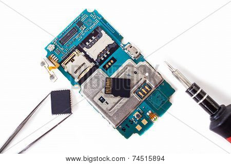 Tools And Disassembled Phone Memory Card