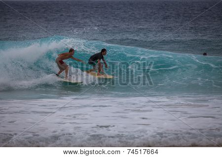 Two Surfers On The Same Wave