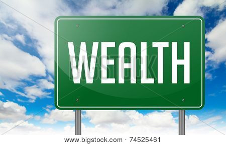 Wealth on Green Highway Signpost.