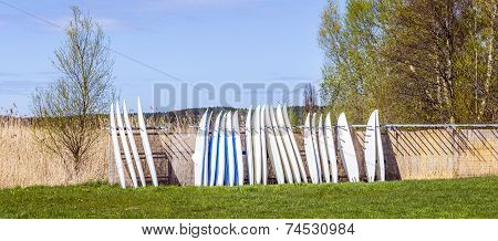 Surfboard Are Stapled At The Beach Of The Backwater In Usedom