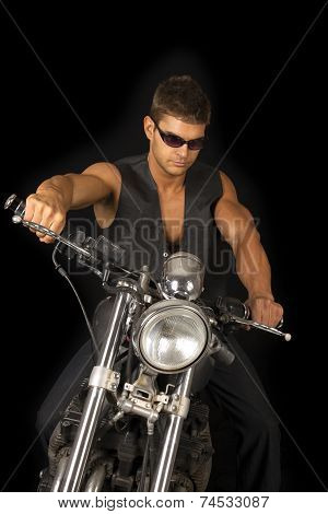 Man On Motorcycle Black Vest Dark Glasses