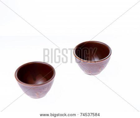 Two Small Sake Or Soju Glasses On White Background
