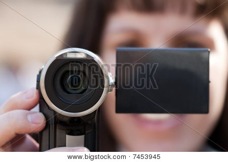Women Holding Camera