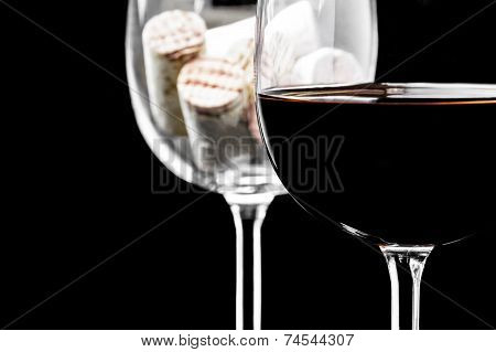 Wine corks and wine glass on a black background