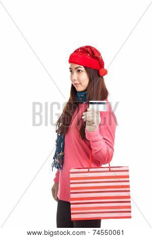 Asian Girl With Red Christmas Hat ,credit Card And Shopping Bag