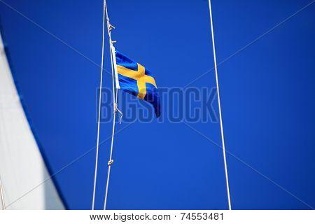 Swedish Flag On Ship Blue Sky On Background