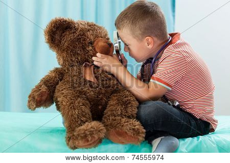 Little Boy Playing On Doctor