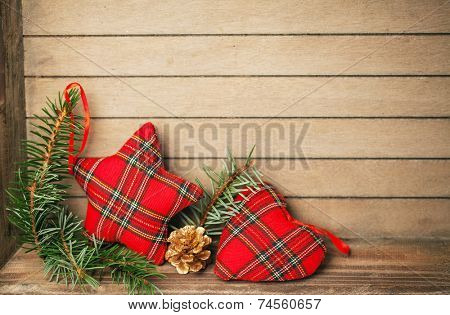 Red checkered star on wooden background