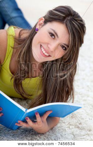 Girl Lying On The Floor Studying