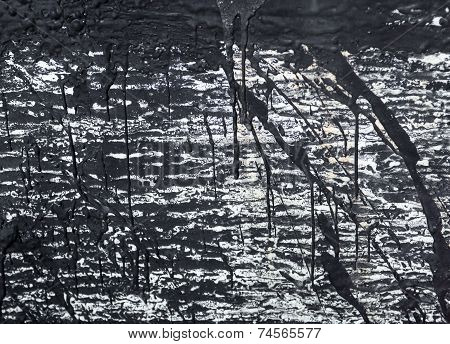The Surface With The Streaks Of Black Tar