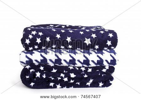 three soft fleece blankets