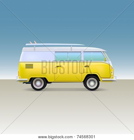 Classic yellow minivan with surfboard. Vintage bus